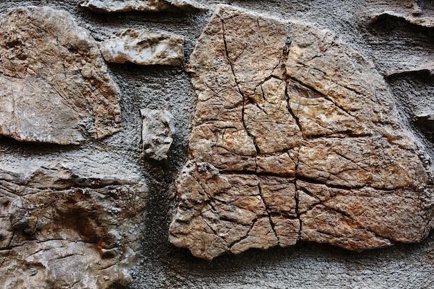 Weefselachtergrond van gebarsten steen van een oud kasteel