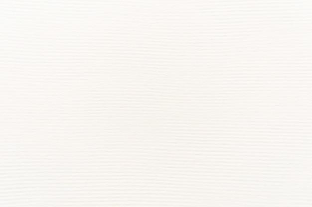 Weefselachtergrond van wit karton