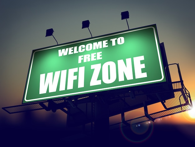 Welkom bij free wifi zone - green billboard on the rising sun background.