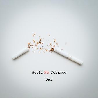 Wereld geen tabak dag belettering op witte achtergrond. stop met roken concept