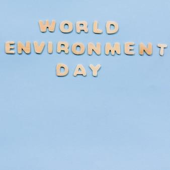 Wereldomgeving dag tekst op blauwe achtergrond