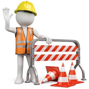 Werknemer met een reflecterend vest en helm leunend op een constructie barrière