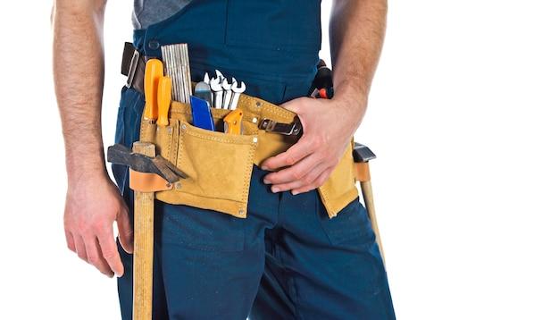 Werknemer met toolbelt detail