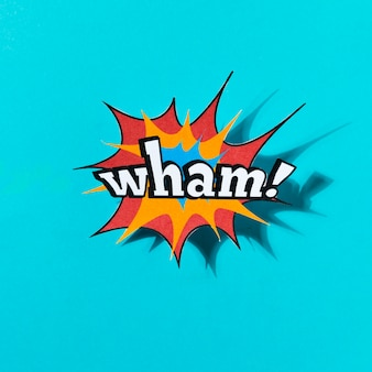 Wham woord stripboekeffect op blauwe achtergrond
