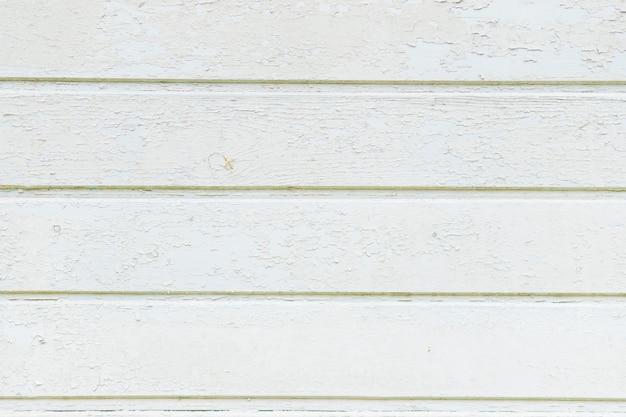 Wijnoogst doorstane sjofele witte geschilderde houten textuur als achtergrond. de rustieke witte textuur van de pastelkleur houten plank houten muur, gedetailleerde textuur als achtergrond met natuurlijke patronen met gebarsten kleur