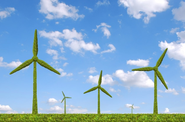 Windturbine, gemaakt door groene gevormde struiken