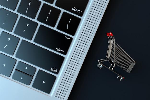 Winkelwagen een laptop toetsenbord. e-commerceconcept
