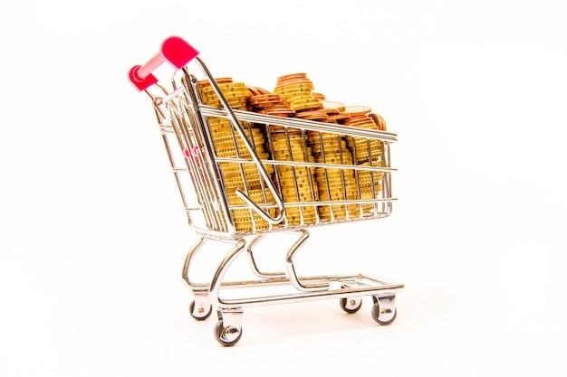 Winkelwagen en munten, geld