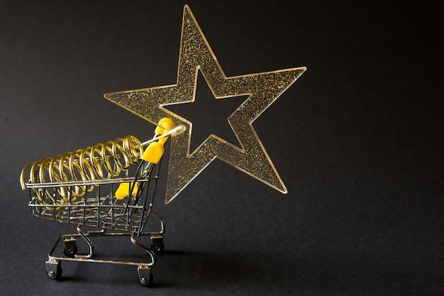 Winkelwagen met een gouden transparante ster