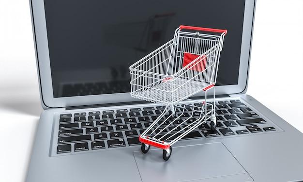 Winkelwagen op een notebook-toetsenbord. online winkelen en e-commerce