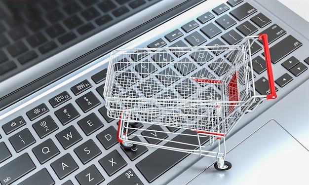 Winkelwagen op een notebook-toetsenbord. online winkelen