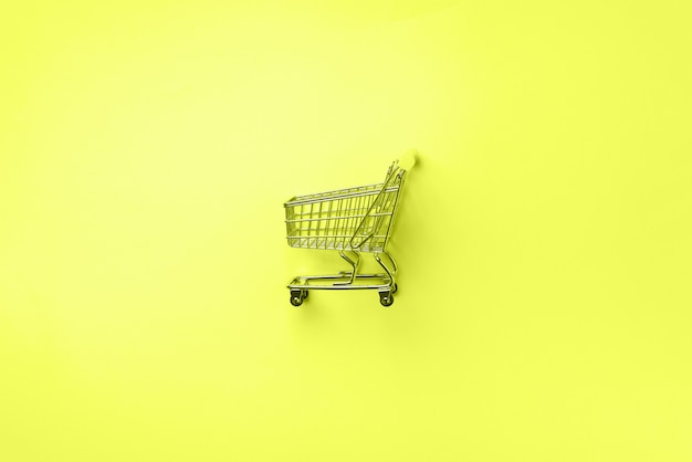 Winkelwagen op neon geel