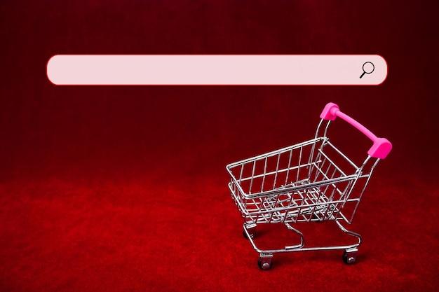 Winkelwagentje met zoekbalk achtergrond zakelijke promotie tijd shopping evenement zoekitem