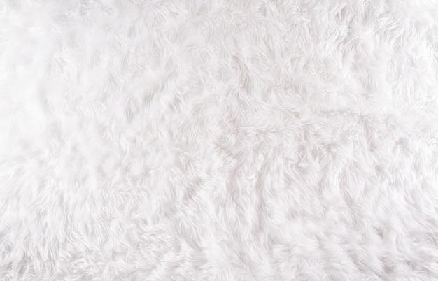 Winter gezellige achtergrond gemaakt van wollen tapijt, bovenaanzicht met kopie ruimte.