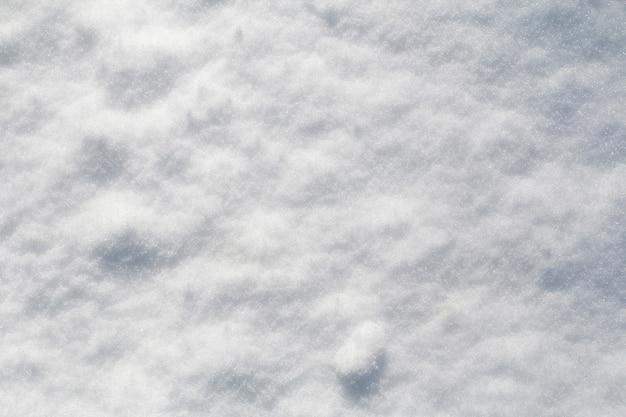 Winter sneeuw sneeuw textuur bovenaanzicht van de sneeuw textuur ontwerp besneeuwde witte textuur sneeuwvlokken