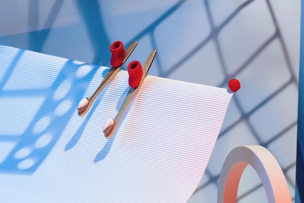 Winter tandheelkundig concept met tandenborstels en tandpasta in de vorm van ski's met rode vilten laarzen die vanaf de berg rijden.
