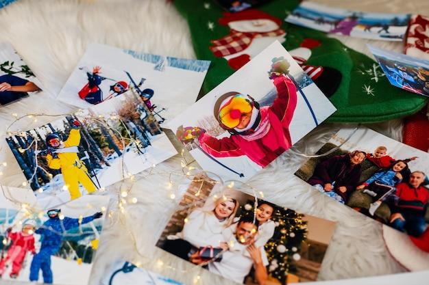 Winterfoto's op de vloer, familiereisfotoboeken, fotoalbum