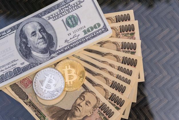 Wissel bitcoin in voor een dollar en japanse yen-bankbiljetten.