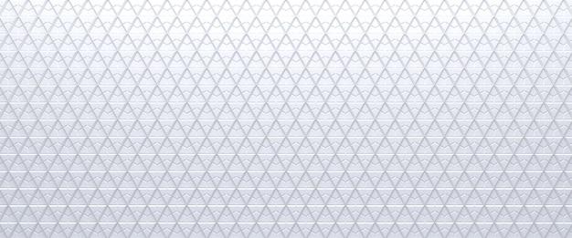 Wit betegelde driehoekige abstracte textuur achtergrond. geëxtrudeerd driehoekenoppervlak. 3d.