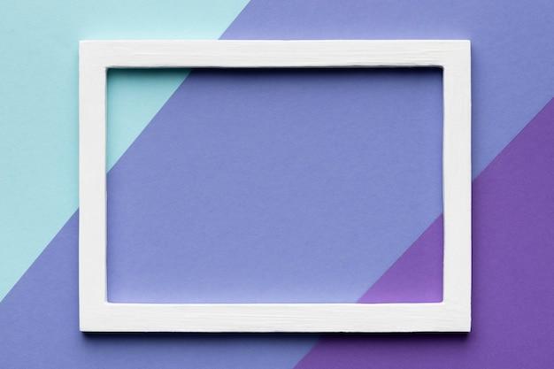 Wit frame op kleurrijke achtergrond plat leggen