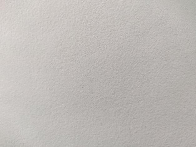 Wit geschilderde getextureerde betonnen wand