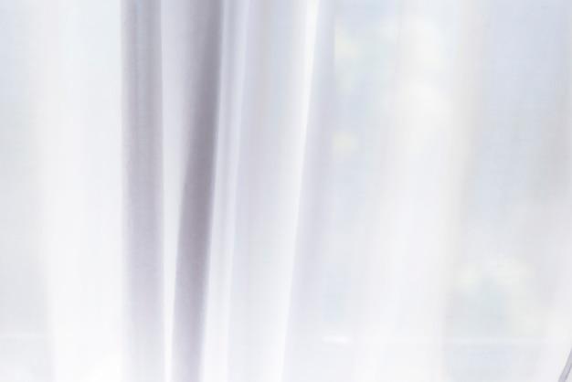 Wit gordijn als achtergrond of textuur