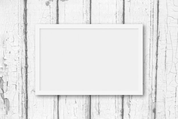 Wit kader op een lichtgrijze houten achtergrond met exemplaarruimte