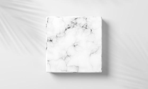 Wit leeg vierkant marmer op witte achtergrond met decoratie door schaduwbladeren