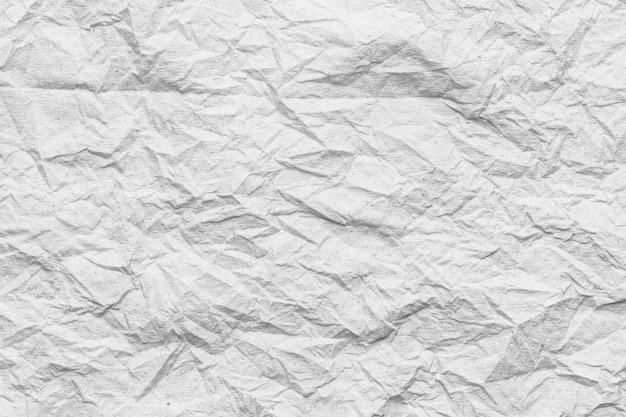Wit weefseloppervlak van kreukels of verfrommeld.
