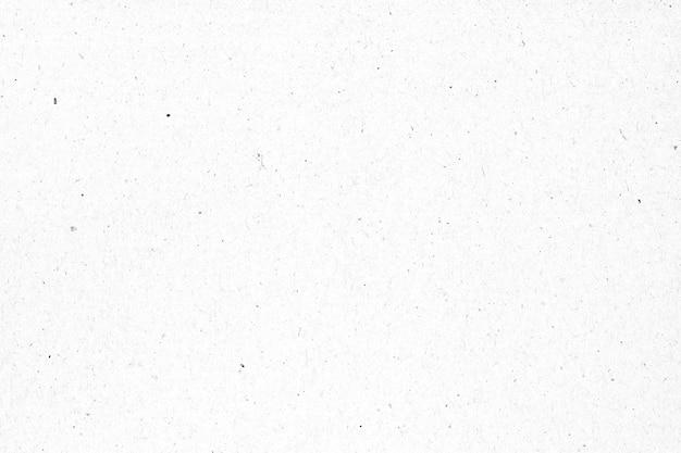 Witboek of kartontextuur met zwarte vlekachtergrond.