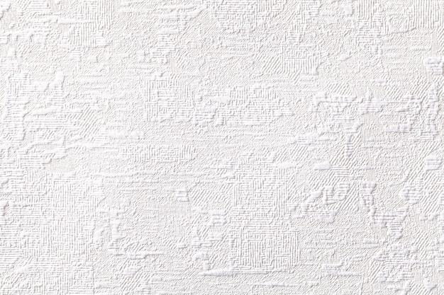 Witte achtergrond met reliëf en gegolfde textuur.