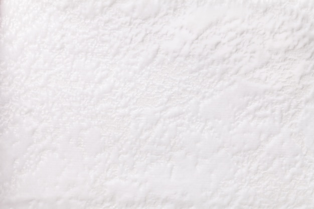 Witte achtergrond van een zacht stofferings textielproduct, close-up.