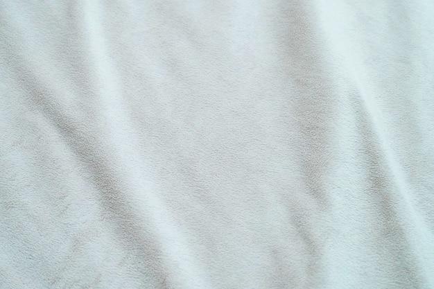 Witte achtergrond van het de textuurmalplaatje van de stoffen de abstracte natuurlijke wol.