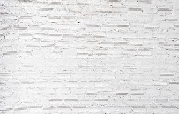 Witte bakstenen muur achtergrond abstracte betonnen vloer of oude cement grunge achtergrond met witte leeg.
