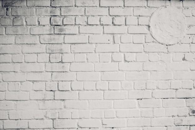 Witte bakstenen muur achtergrond. witte bakstenen binnengevelmuur. oude cement grunge achtergrond Premium Foto