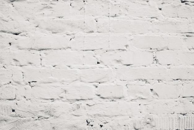 Witte bakstenen muur achtergrond. witte bakstenen binnengevelmuur. oude cement grunge achtergrond