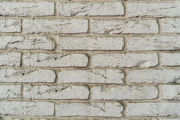 Witte bakstenen muur. het patroon van baksteen met witte vulling