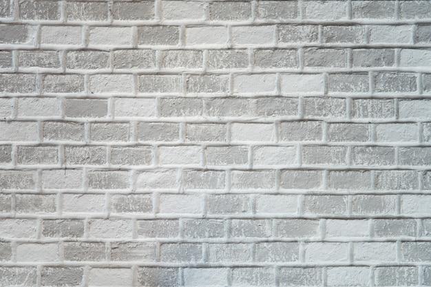 Witte bakstenen muur in retro en vintage stijlen geschilderd in witte kleur.