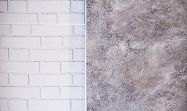Witte bakstenen muurblokken en zolderachtergronden.