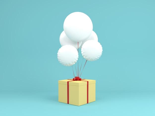 Witte ballon met gele geschenkdoos op blauwe pastel achtergrond