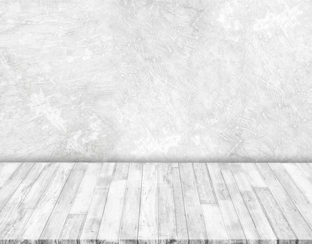 Witte betonnen muren en witte houten vloeren