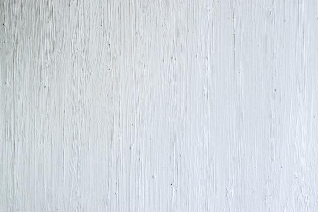 Witte betonnen muur met penseelstreken