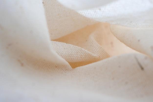 Witte de doek van de calicostof textuur als achtergrond
