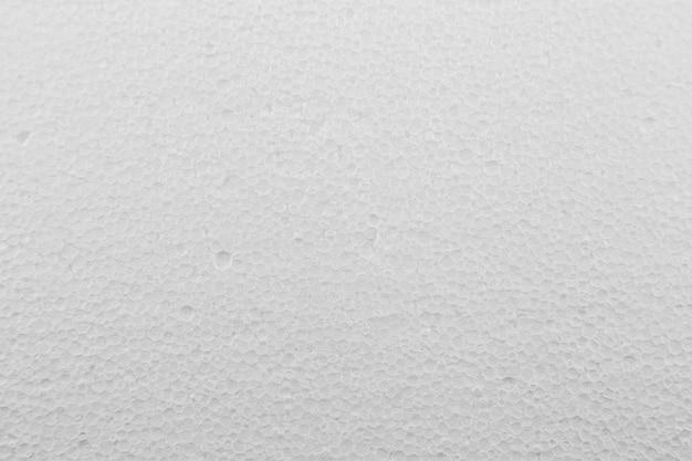 Witte de textuurachtergrond van het schuim plastic blad