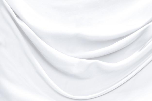 Witte doeksamenvatting als achtergrond met zachte golven.