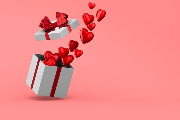 Witte doos met rode strik en harten op roze.