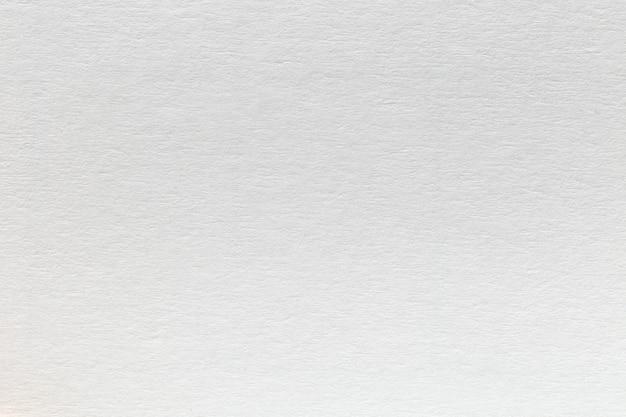 Witte eco gerecycled kraftpapier blad textuur kartonnen achtergrond.