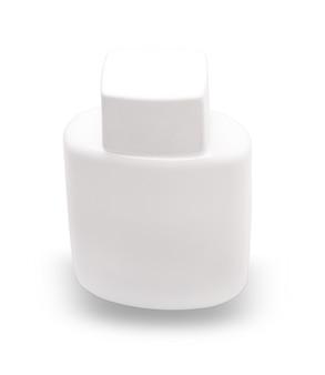Witte fles met scheerschuim uitgesneden op wit oppervlak