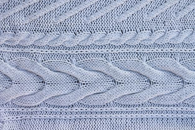 Witte gebreide trui achtergrond. bovenaanzicht. kopieer ruimte