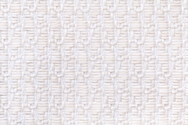 Witte gebreide wollen achtergrond met patroon van zachte, wollige doek.